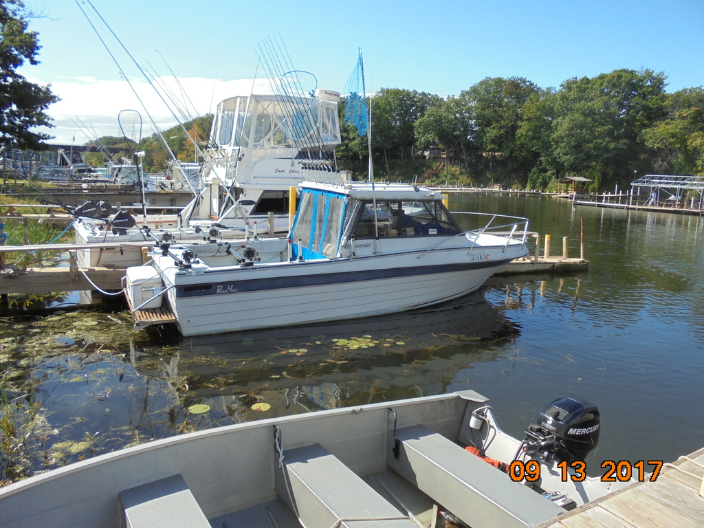 Looking for a hard top fishing boat. Penn Yan contender or ...