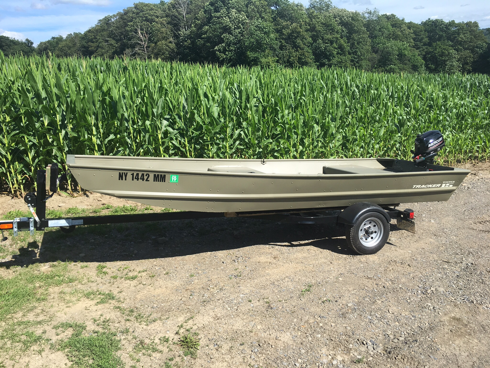 Brand new 1552 tracker Jon boat, trailer and 5 hp Mercury 4
